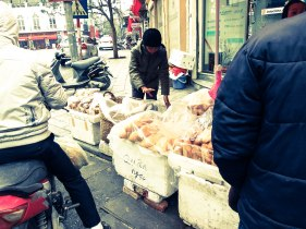 Selling baguettes in the streets of Hanoi.